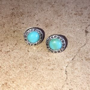 Silver stud earrings with blue stones.